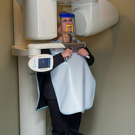 A woman getting a scan before her surgical endodontics